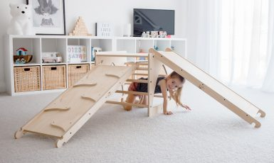 Wooden furniture for kids with little girl playing under it