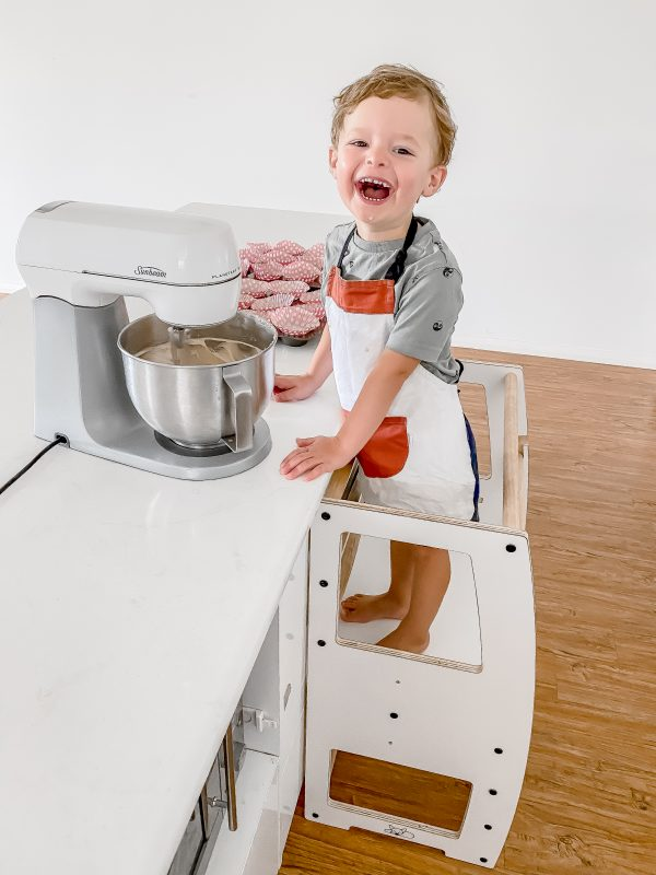 Boy mixing a cake using the My Little Double Helper in White