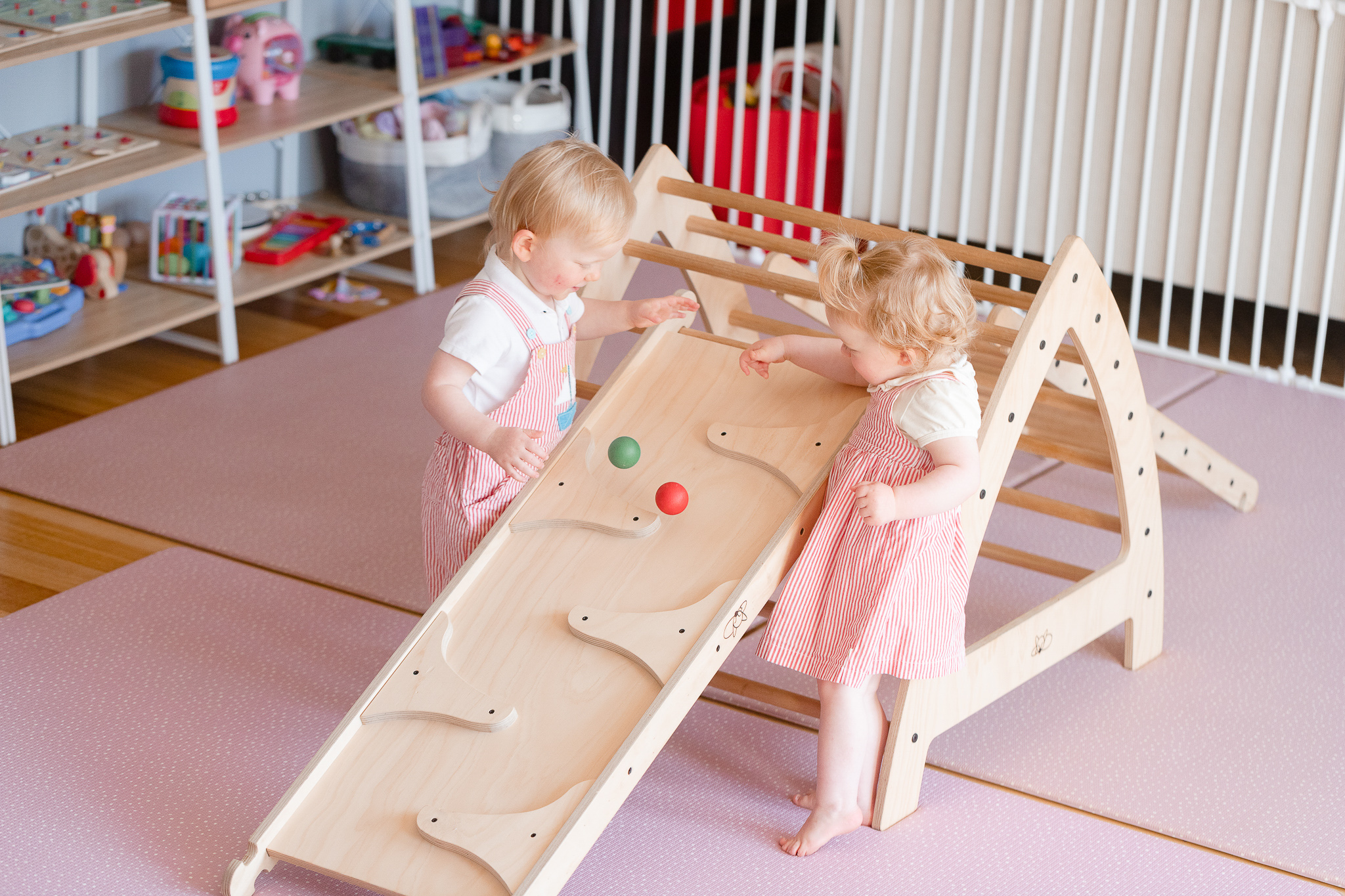 A girl rolling her marbles down the marble run