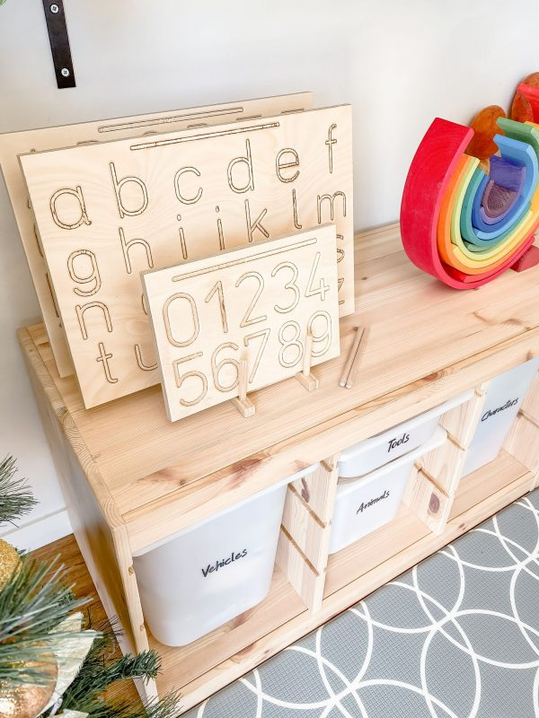 Tracing boards on storage box with rainbow wooden toy