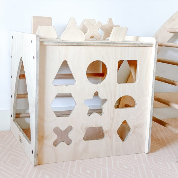 Shape sorter cube with lots of different wooden shapes