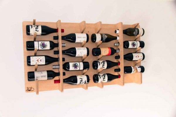 A wall mounted wooden wine rack with wine bottles