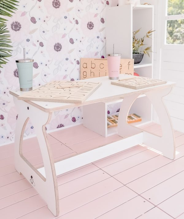 A white activity table for children