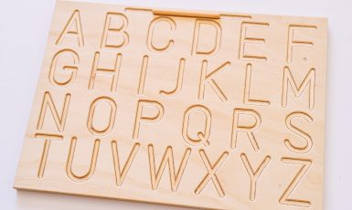 A wooden capital letter tracing board
