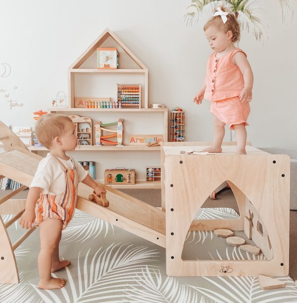 Toddlers playing on Wooden shape sorter