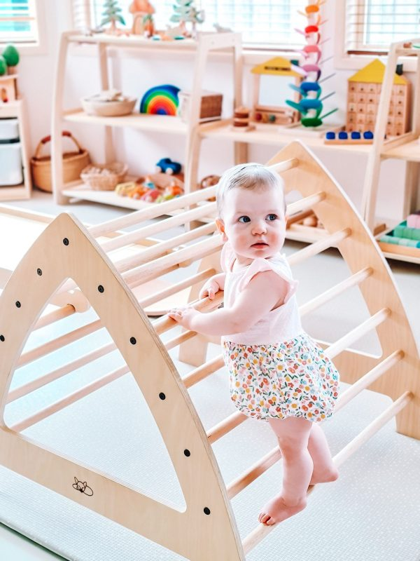 Large Pikler Arch with baby climbing it