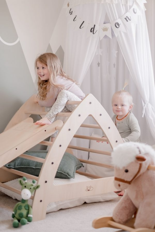 Large Pikler Arch being enjoyed by two children
