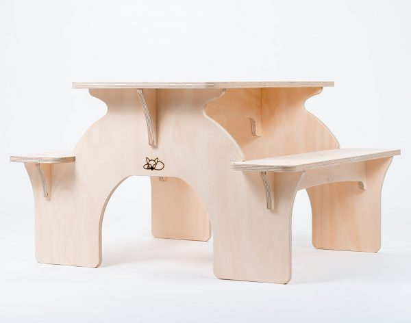 A wooden children's picnic table