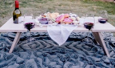 rectangle table with wine and cheese