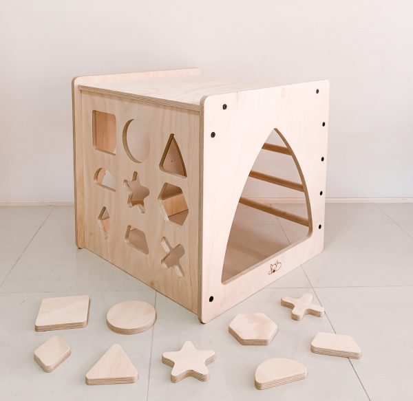 A shape sorting cube for children