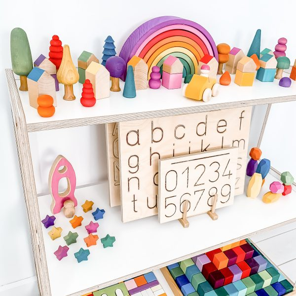 Tracing boards on shelf with Montessori toys for children