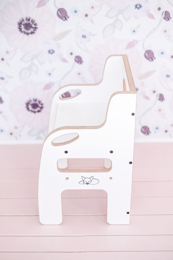 Side view of white weaning chair for toddlers
